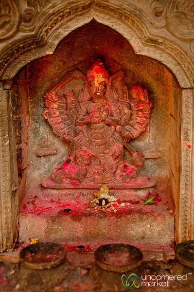 A Religious Statue Covered in Red Powder - Patan, Nepal