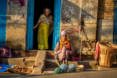 Old couple in front of their home in Kathmandu, Nepal