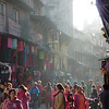 A busy street in Kathmandu, full of color and life. Women shop the clothing and textile shops.