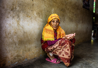 Very old woman begs in a local retirement home, Nepal