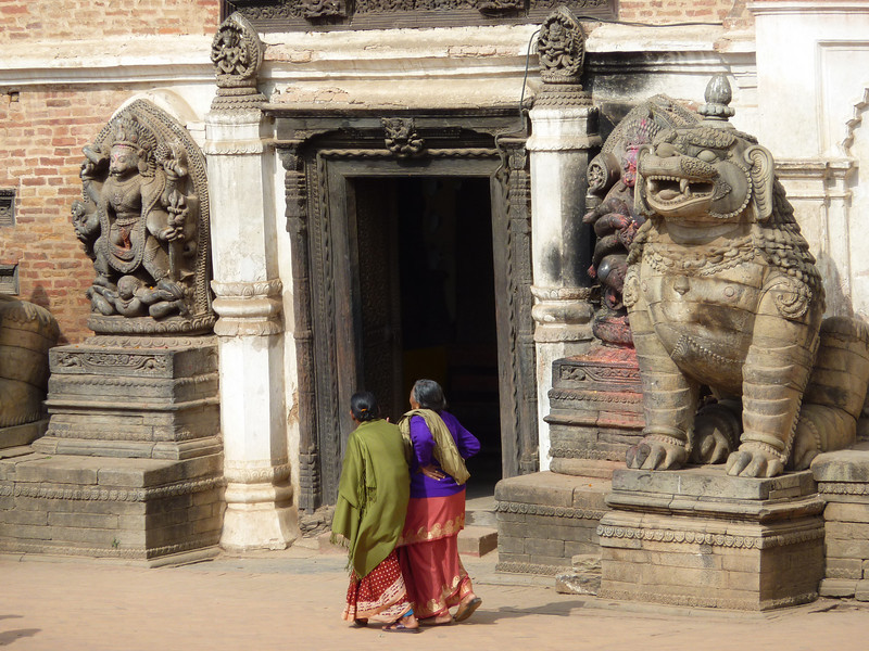 Two Nepali women in a courtyard in Bhaktapur, one of the best preserved historic towns in Nepal.