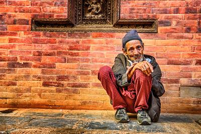 Old beggar in the street of Kathmandu, Nepal