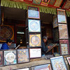 At this art store, painters work on their Thangka paintings, which depict the circle of life, the steps for attaining nirvana, or the various levels of existence (i.e. heavan, earth, and hell).