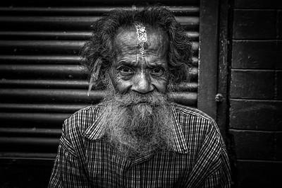 Old man sitting in the street of Kathmandu, Nepal