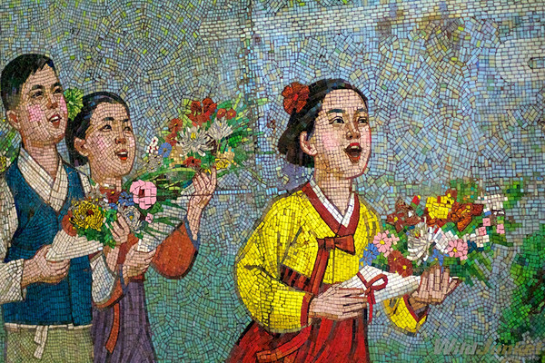 Propaganda art on mosaic wall