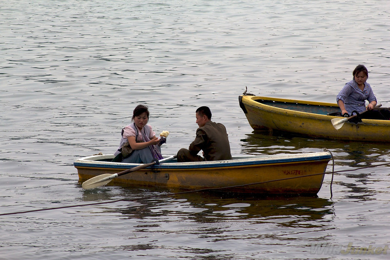 Couples rowing boat on the river
