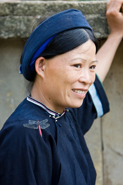 Minority tribeswoman with a dragonfly on her shoulder.<br /> <br /> Location: Unknown village, northern Vietnam<br /> <br /> Lens used: 24-105mm f4.0 IS