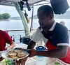 Chef, Morris Luke, serving lunch on top deck