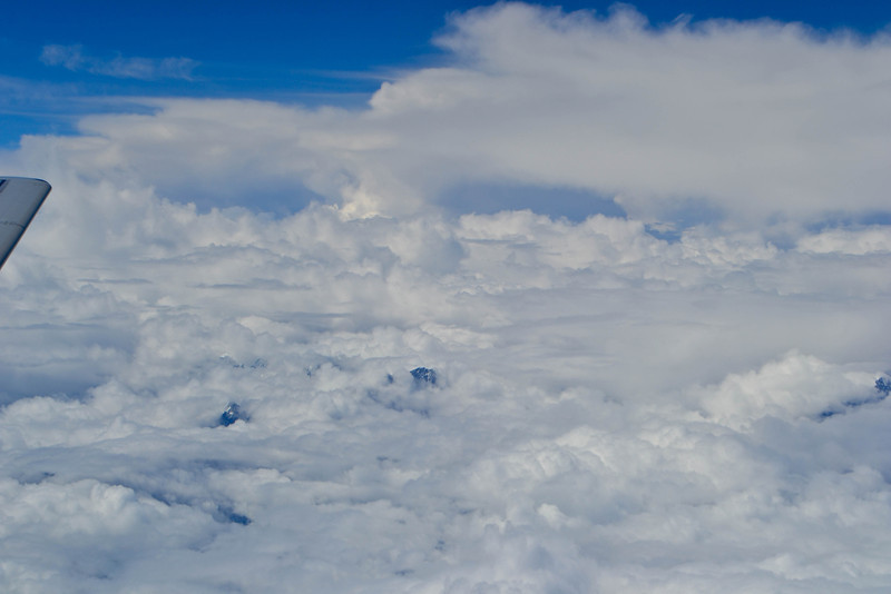 Flying over a cloud-obscured Mount Everest on the way to Bhutan. So glad we got to see it the day before!