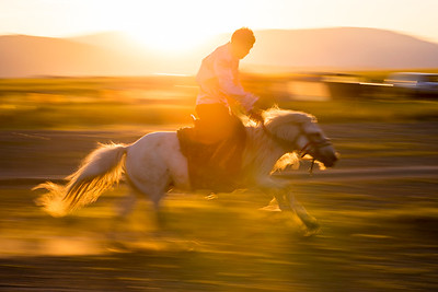 A Khazak practices for buzkashi in the sunset light