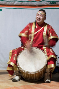 A drummer in traditional costume with his band