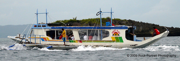 Outrigger boats transfer us to our destination - Boracay
