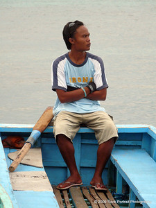 Chilling out while waiting to transport his set of tourists to the main boat