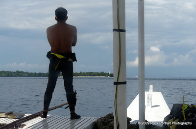 Our intrepid DiveMaster does his best shark hunter impression whilst spotting the best anchorage.