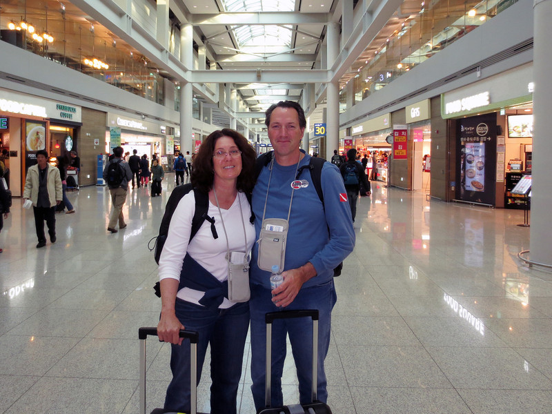 Merry & Fil (all showered) at ICN - Seoul/Incheon Airport, transiting to MNL - Manila.