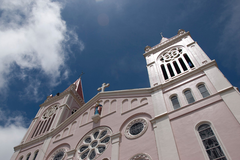 Looking up the Baguio Cathedral and clear blue sky - Baguio, Philippines
