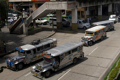 Jeepneys at a busy intersection in Baguio, Philippines
