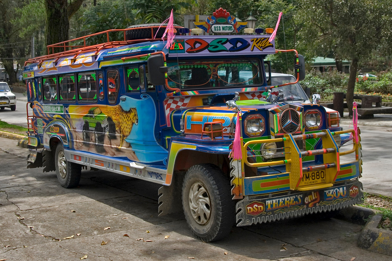 Full profile of parked colorful jeepney in Baguio, Philippines