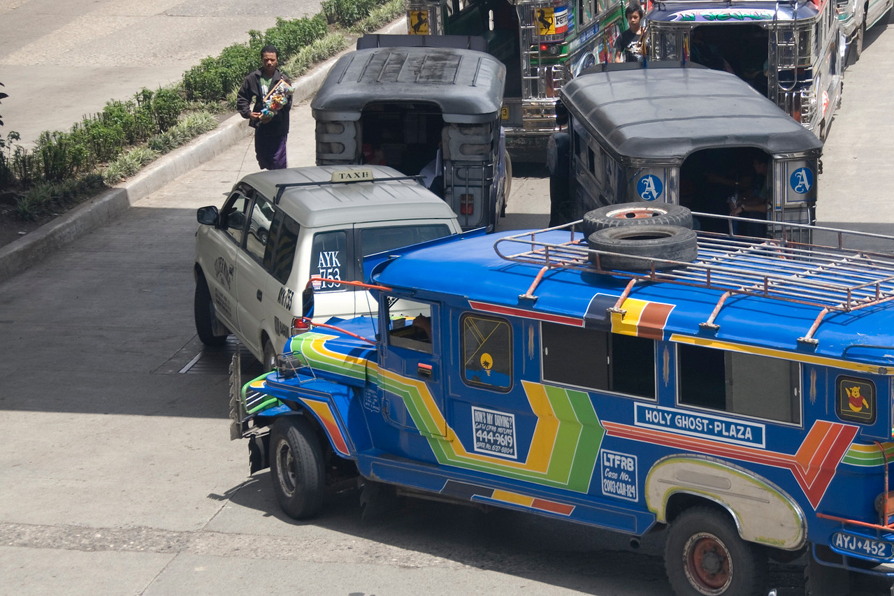 Jeepneys, taxis, and peddlers at the street of Baguio, Philippines