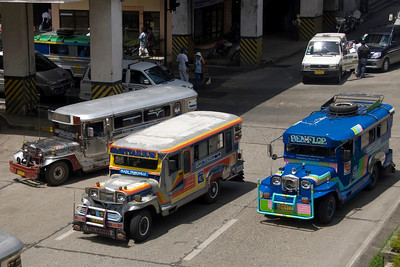 Colorful jeepneys on busy street of Baguio,  Philippines