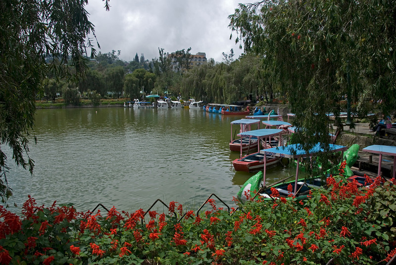 Boats docked on a pond inside the Burnharm Park at Bagiuo, Philippines