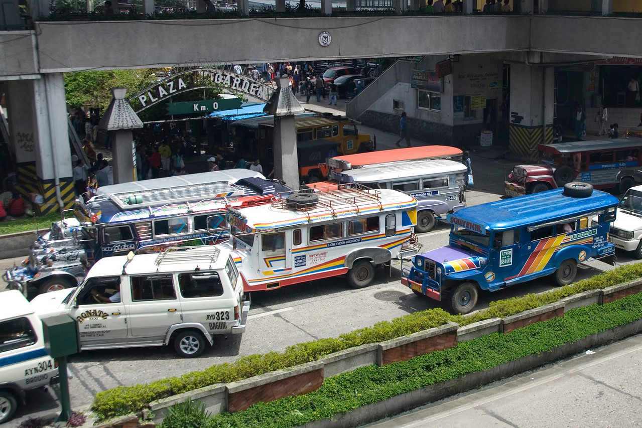 Jeepneys passing through a busy highway in Baguio, Philippines
