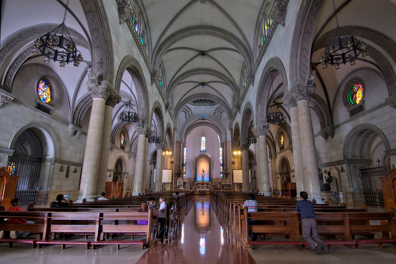 Worshippers kneeling on pews at Manila Cathedral, Philippines