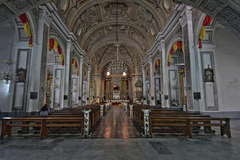 Looking at the aisle and altar at St. Augustine's Church, Manila
