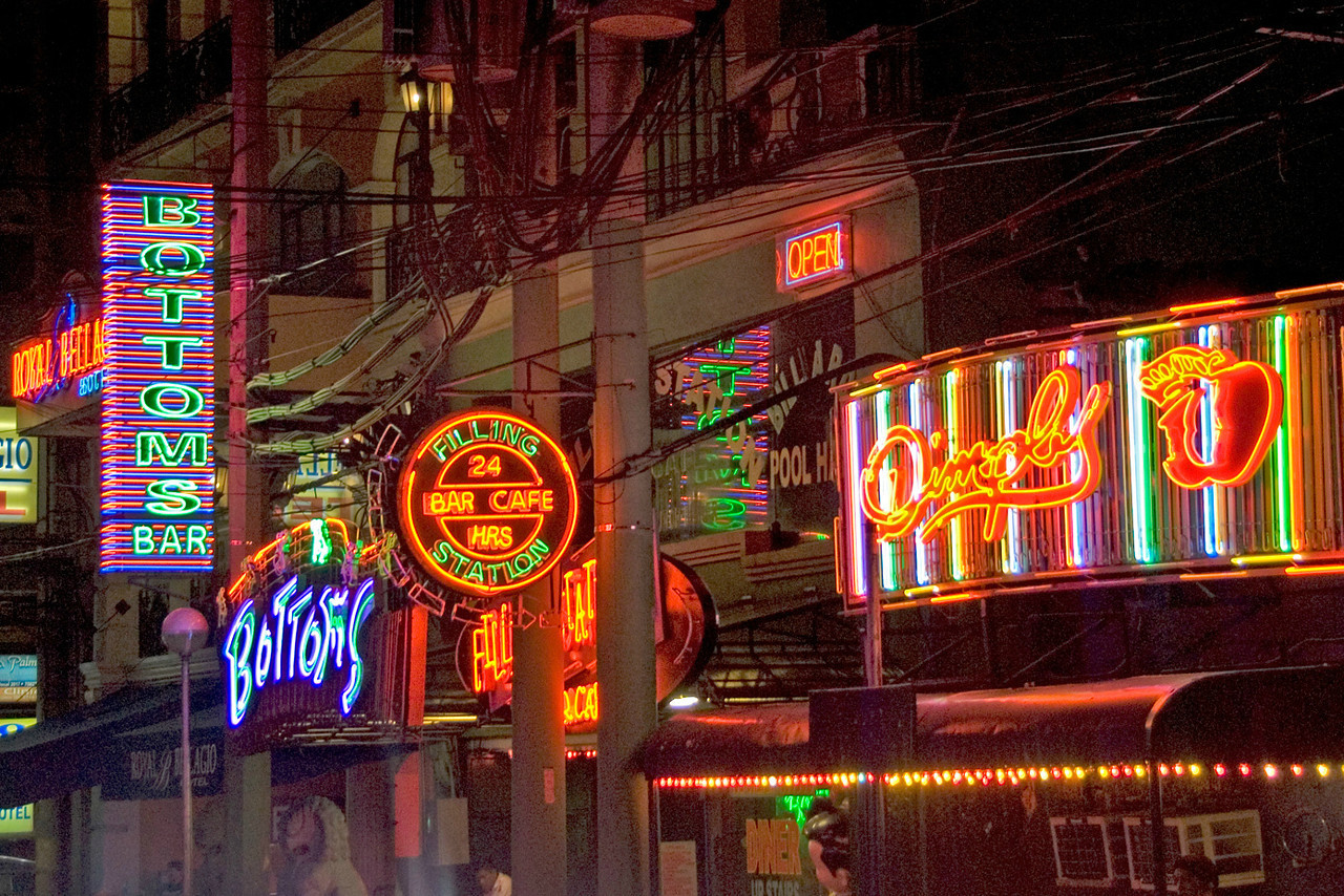 Bright neon lights at night in Makati, Philippines