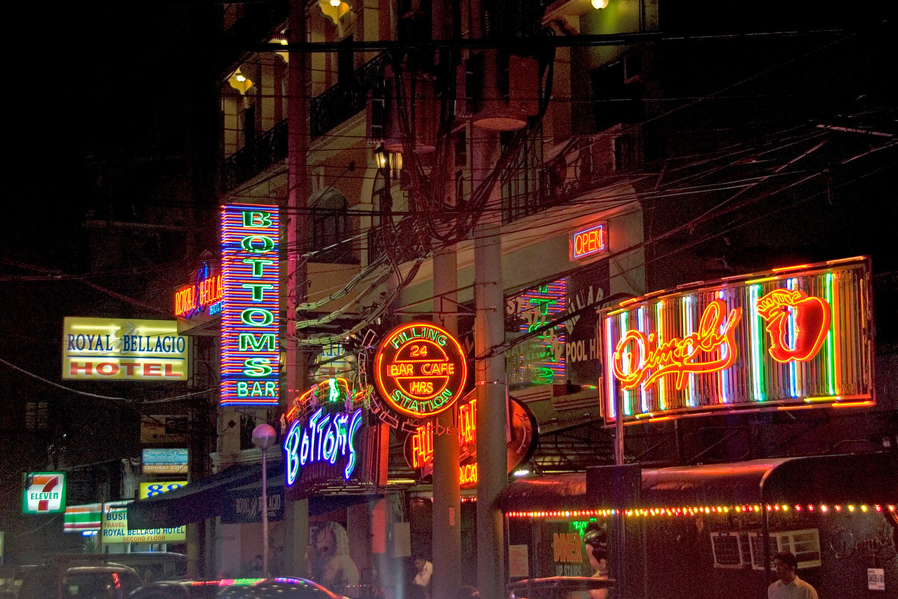 Bright neon sights at night in Makati - Manila, Philippines
