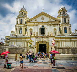Colorful street life scene around Quiapo Church.