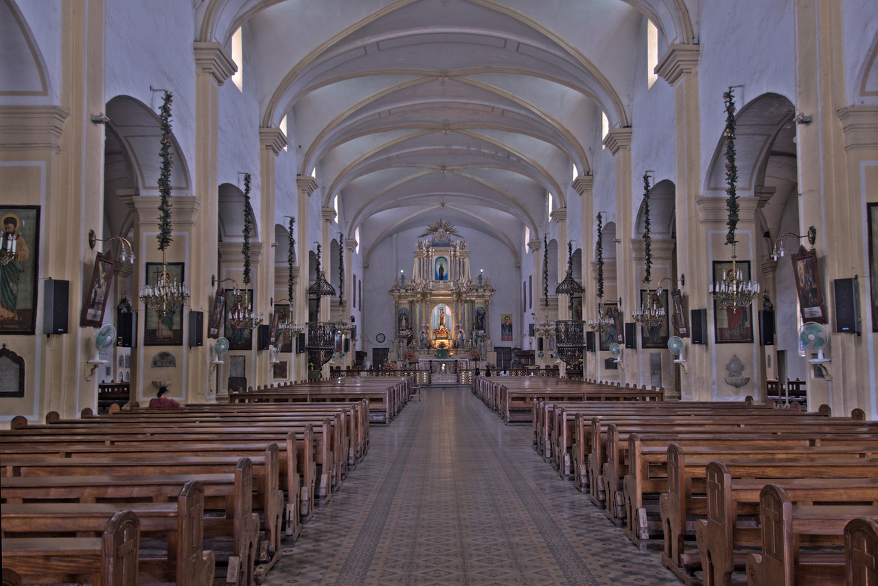 The pews and altar inside the Vigan Cathedral - Vigan, Philippines