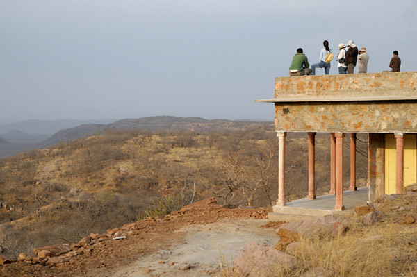 "This is at the highest point in the park. The second rightmost figure is Uncle Mahi who kindly let me join him on this trip. He regularly comes to Ranthambhore and has been following Machali and her cubs for the past few years. Check out his website: <a href=""http://www.bamsafari.com"">http://www.bamsafari.com</a>"