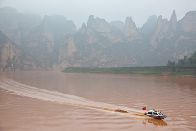 Speed boat on Yellow River near Bingling Si, Gansu Province, China
