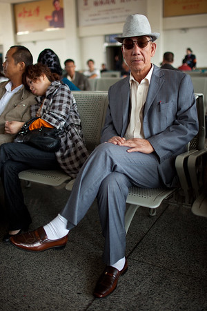 Urumqi, China - September 22, 2009: Portrait of a senior man in the train station waiting room in Urumqi. (Photo by: Christopher Herwig)