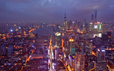 Shanghai, China - September 3, 2009:  Nightview of Shanghai down East Nanjing Road towards the Huangpu River and the Pudong business district with some of the tallest buildings in the world. (Photo by: Christopher Herwig)