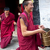 Tibetan monks carrying bowls for lunch at the Labrang Monastery, one of largest Tibetan Monasteries outside of Tibet.