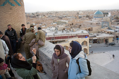 Yazd, Iran - February, 2008: Group of young Iranian girls enjoying a rooftop view over the desert city of Yazd, famous for its many wind towers which act as a natural air conditioner. (Photo by Christopher Herwig)