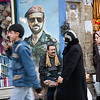 Aleppo, Syria - January, 2008: Busy street in Aleppo with a large mural of Basil al-Assad, the son of former President Hafez al-Assad. Basil was thought to be in line to become the next president but died in a car crash in 1994. (Photo by Christopher Herwig)