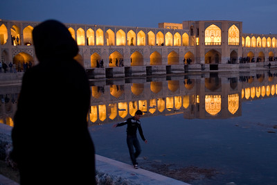 Esfahan, Iran - February, 2008: Khaju Bridge in Esfahan, Iran spans the Zayandeh River and is a popular hangout for locals in the evening. (Photo by Christopher Herwig)