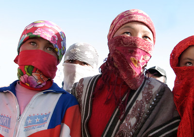 School girls with faces covered from the harsh elements