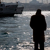 Istanbul, Turkey - January, 2008:  Man standing along the water of Golden Horn in Istanbul, Turkey. (photo by: Christopher Herwig)