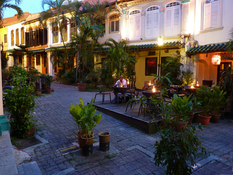 A secluded coffee shop on Emerald Hill, during the quiet hours before the Singapore evening rush.