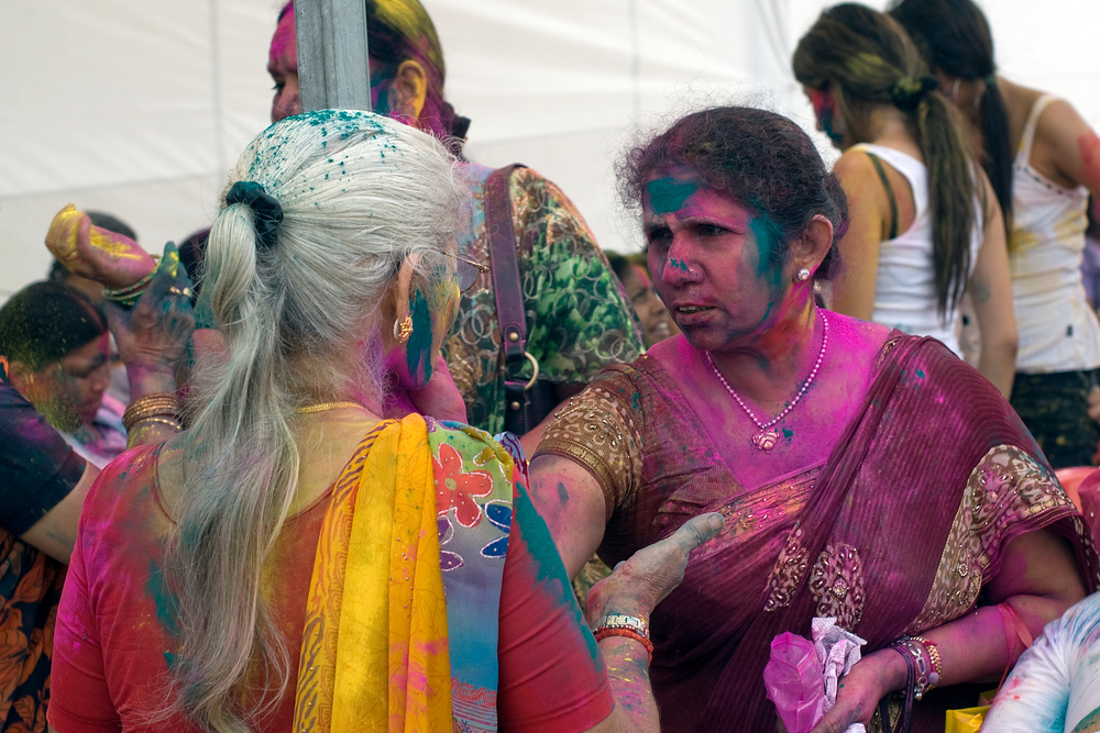 Women applying dye at the 2010 Singapore Holi Festival