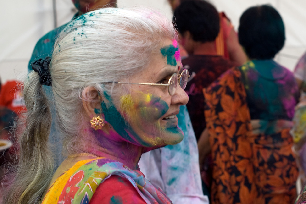 Side profile of a color-splattered woman at Holi Festival in Singapore