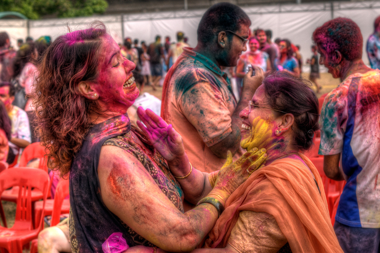 Women wiping color on each other's faces - Little India, Singapore