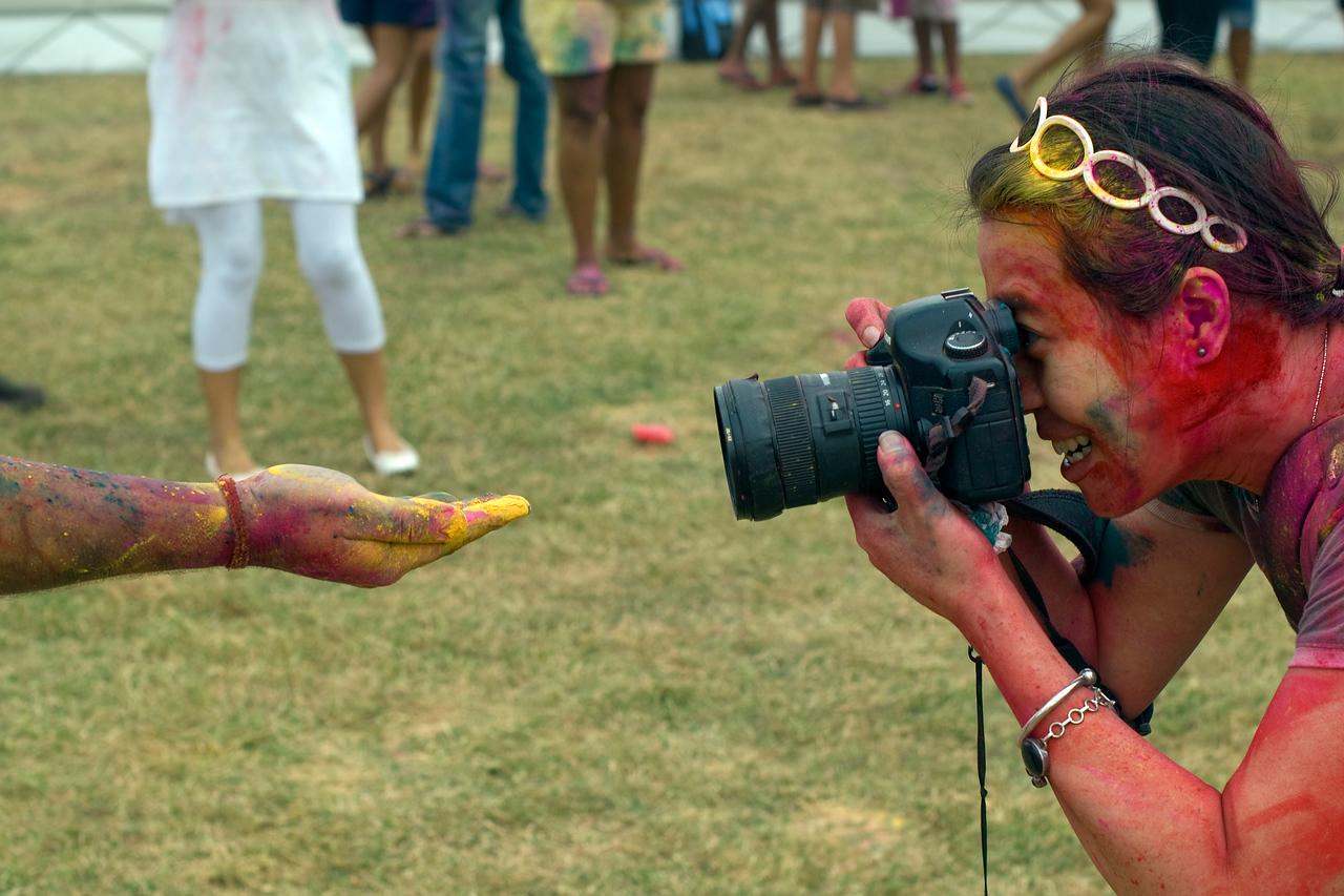 Female photographer shooting festival participant in Singapore