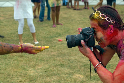 Female photographer shooting festival participant in Singapore