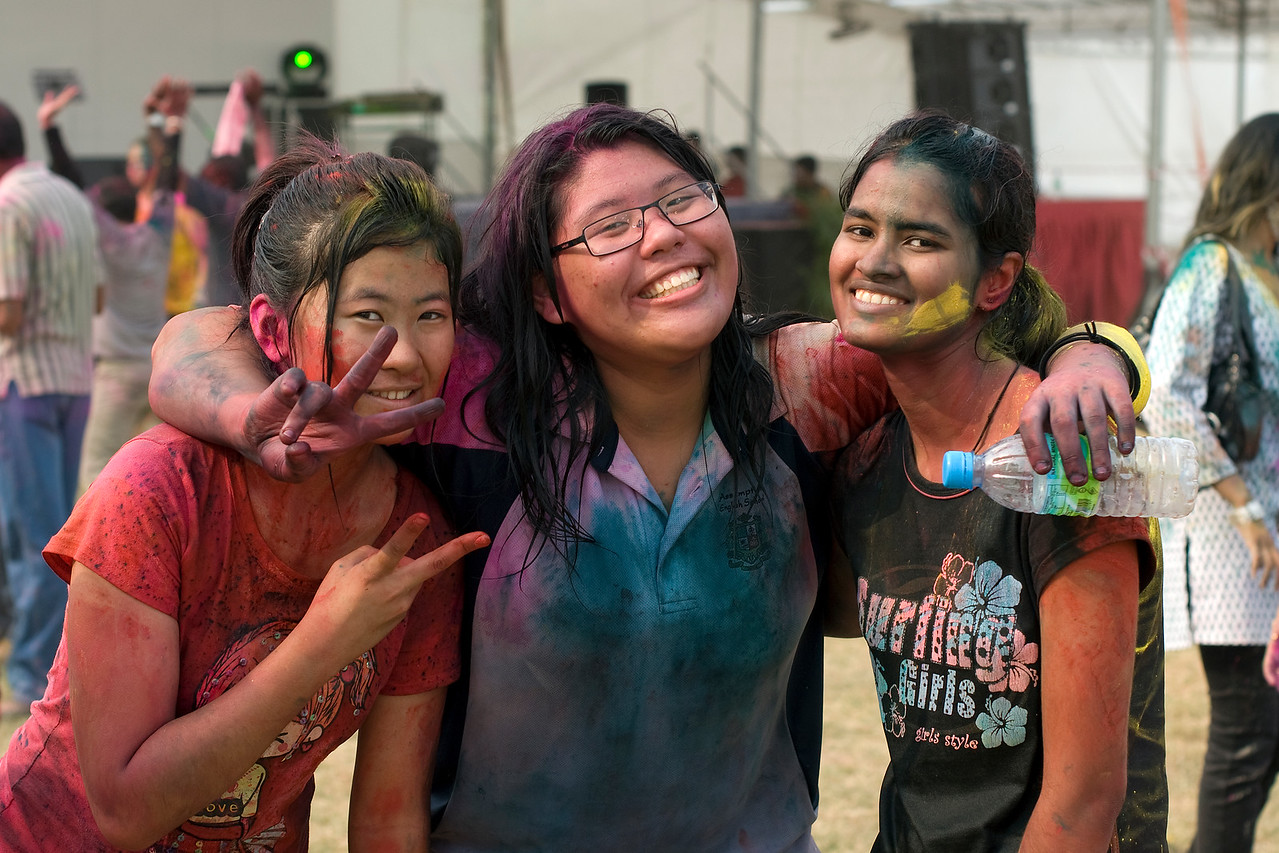 Girls smiling to the camera during Singapore Holi Festival