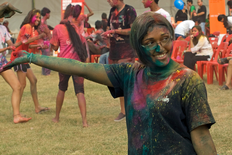 Woman covered in powdered color at Festival of Colors in Singapore